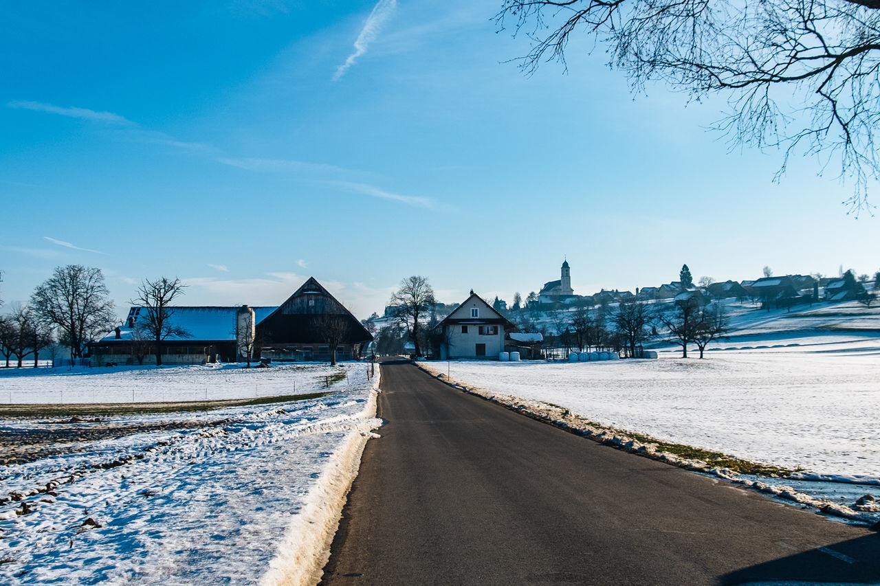road, building exterior, built structure, the way forward, architecture, sky, outdoors, day, tree, transportation, no people, bare tree, nature, snow