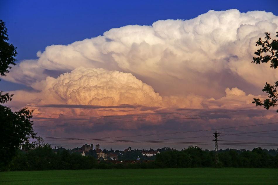 A big cumulunimbus cloud (thunderstorm cloud) above (behind) my hometown. Beauty In Nature Cloud - Sky Cumulunimbus Landsberg Am Lech  Landscape Mountain Nature Night No People Outdoors Scenics Sky Sunset Thunderstorm Tree Weather