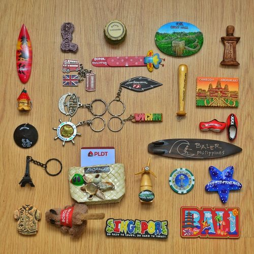 Flatlay Large Group Of Objects Directly Above Arrangement Variation Indoors  Multi Colored Order Preparation  Collection Ideas Freshness Retail  Abundance Group Of Objects Various Memories Flatlay Travel Souvenirs Keychains  Ref Magnet