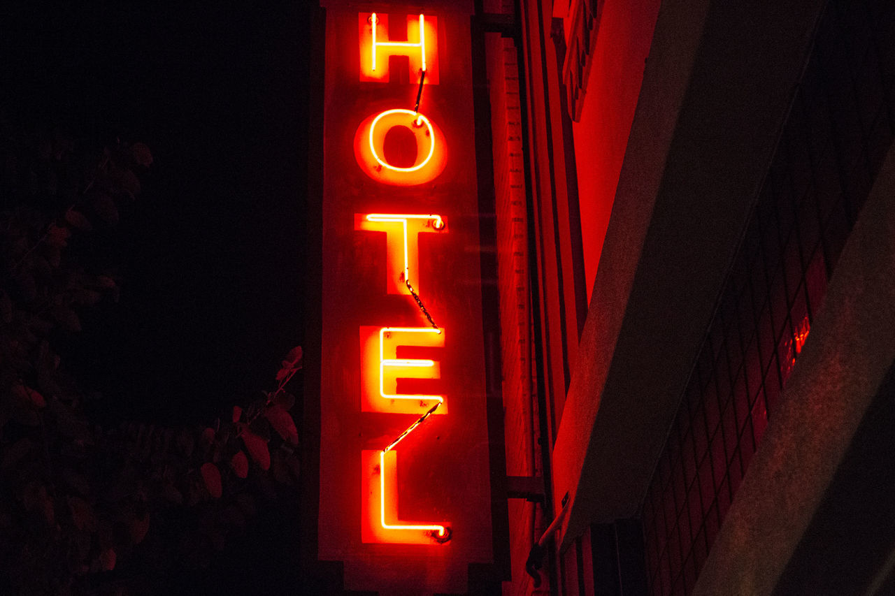 Bright Close-up Communication Creepy Dark Hotel Illuminated Light Lighting Equipment Neon Neon Lights Neon Sign Night No People Outdoors Red Red Scary Text Vacation