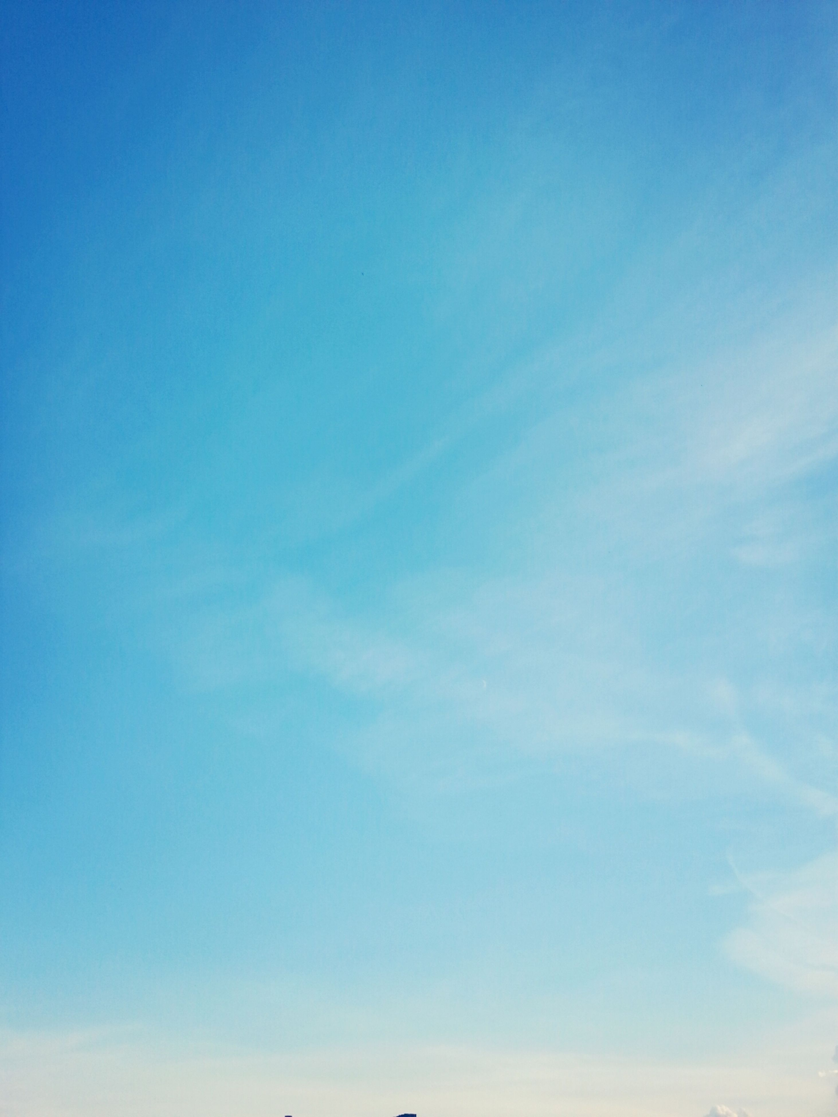 blue, low angle view, sky, beauty in nature, tranquility, copy space, scenics, tranquil scene, nature, outdoors, idyllic, clear sky, day, no people, cloud - sky, sky only, backgrounds, cloud, sunlight, white color