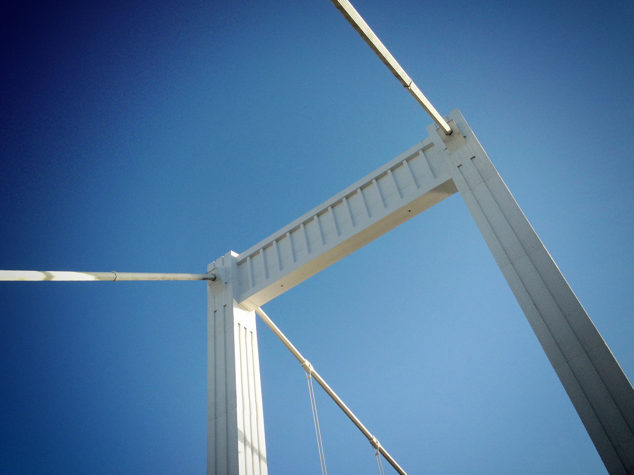 low angle view, blue, clear sky, day, outdoors, no people, sunlight, built structure, alternative energy, architecture, sky