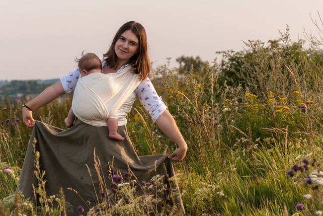 Welcome to my fairytale! Baby Baby Sling Baby Wrap Babywearing Bonding Childhood Children Family Field Front View Golden Hour Grass Happiness Lifestyle Love Maternity Mom Mother And Son Motherhood Outdoors Parenting Sling Smiling Summer Woman