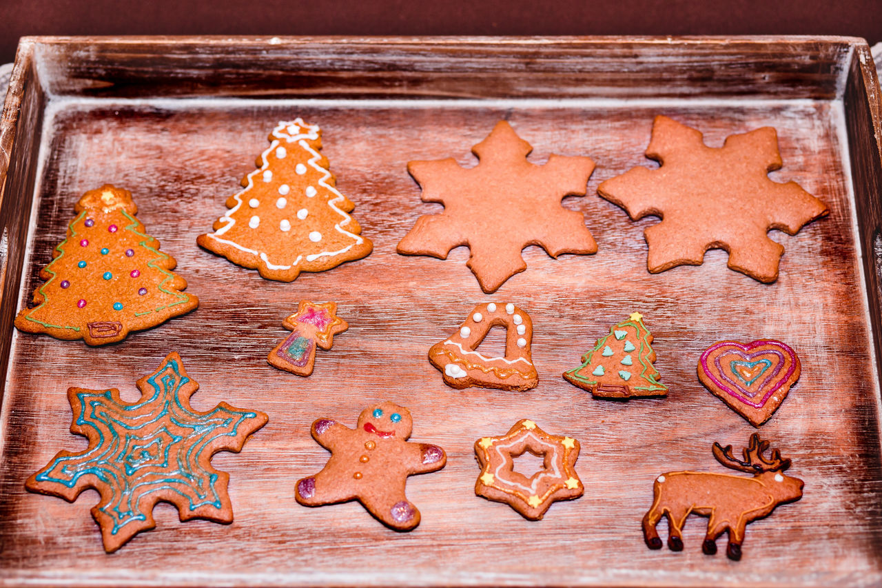 Christmas cookies decorated with frosting on wooden board Baked Baking Biscuits Celebration Celebration Christmas Close-up Cookie Cookies Cooking Decorated Food Frosting Gingerbread Handmade Holiday Homemade Icing No People Preparation  Preparing Food Sugar Sweet Tradition Traditional