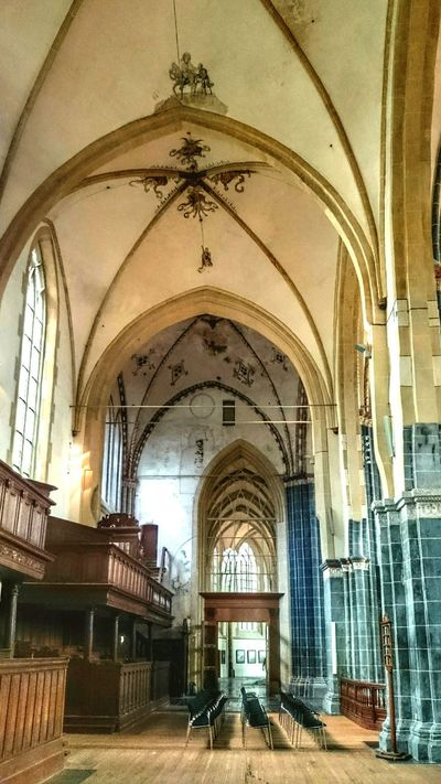 Visiting the Old Church, Looking Up and Enjoying The View of Colorful Light And Shadow and Middle AgeWallpainting. Interesting Interiors