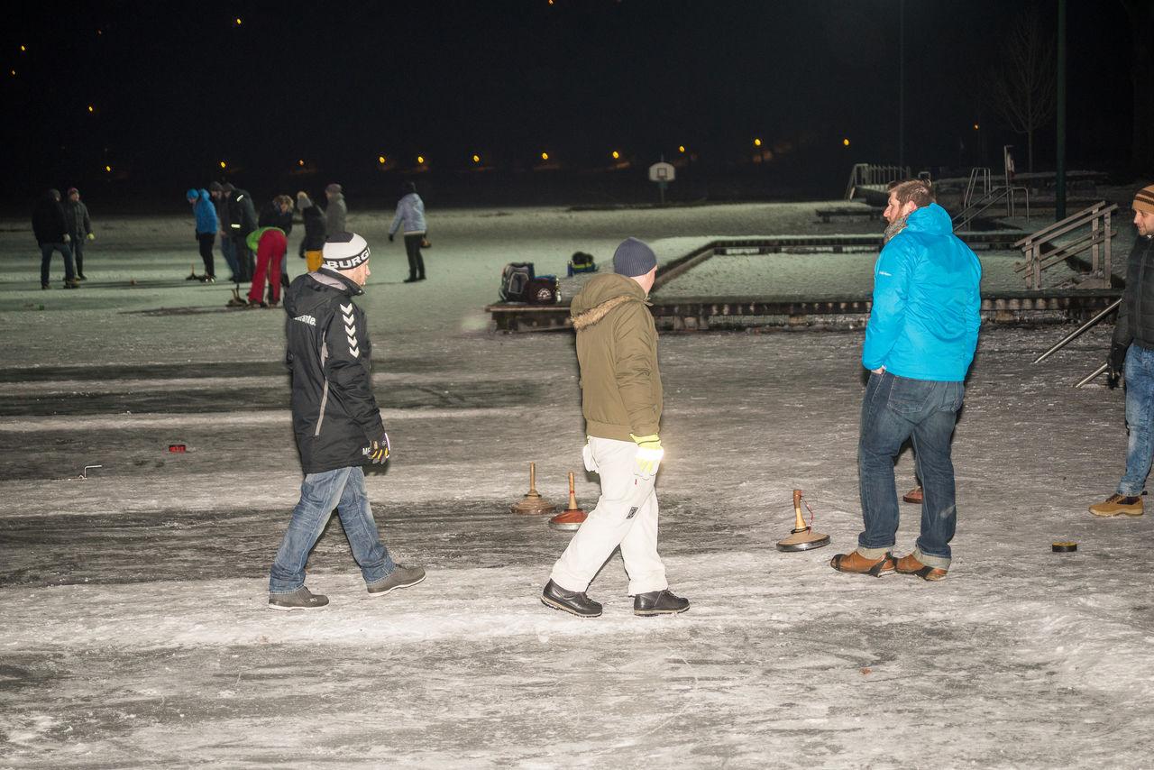 People playing curling on frozen lake Burghausen Curling Fun Germany People Winter Winter Sports Winter Sports On The Frozen Lake