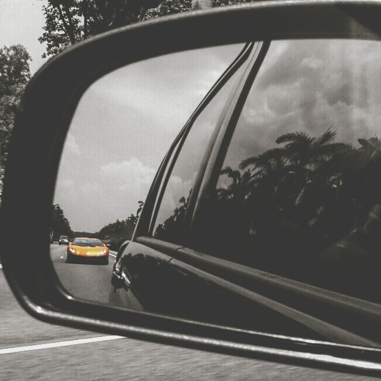 Took this Lamborghini shot through rearview mirror. Orange Lamborghini Rearviewmirrorshot ThrowBackSaturday