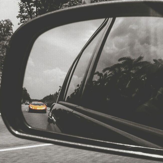 Took this Lamborghini shot through rearview mirror. Orange Lamborghini Rearviewmirrorshot ThrowBackSaturday