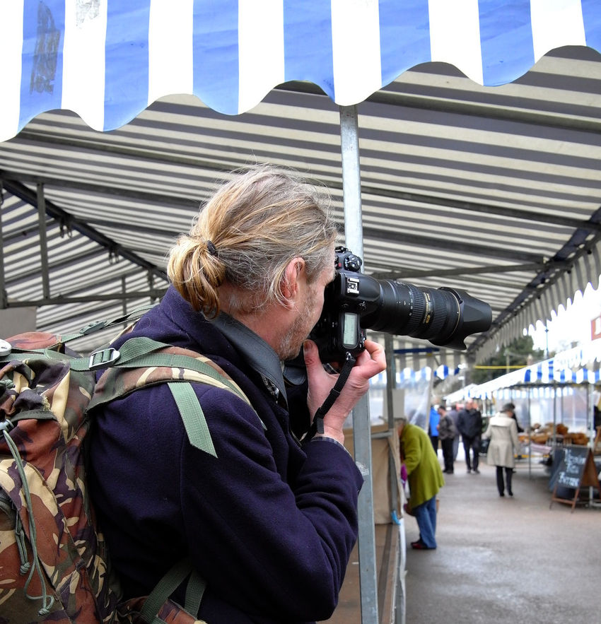 Candid camera...I took a quick snap of this professional-looking photographer, while I was at Ludlow Market. He didn't see me - luckily. Shropshire Leica Ludlow Farmers Market Noedit