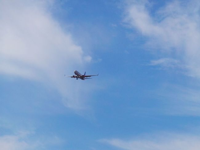 Air Vehicle Airplane Blue Blue Sky Cloud Cloud - Sky Day Flying Journey Landing Landing Stage Low Angle View Mid-air Mode Of Transport No People On The Air On The Move Sky Transportation Travel