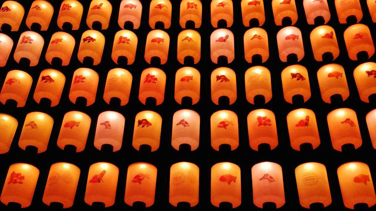 Full Frame Shot Of Orange Illuminated Japanese Lanterns At Night