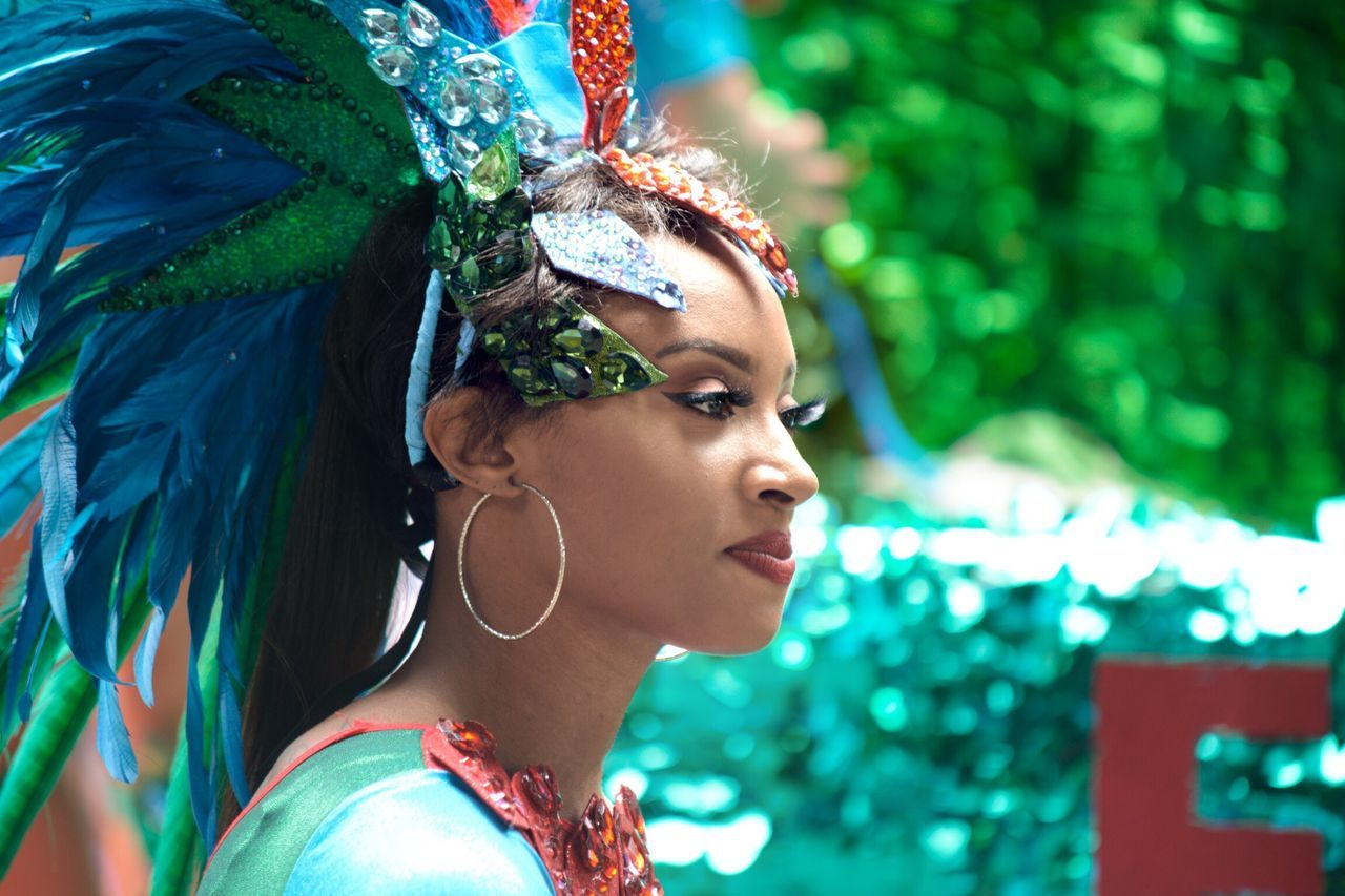 Carnaval Parade in San Francisco Young Adult Real People Headshot Feather  One Person Lifestyles Arts Culture And Entertainment Young Women Beautiful Woman Fashion Outdoors Hair Bun Leisure Activity Dancer Day Headwear Portrait Headdress Close-up Adult The Street Photographer - 2017 EyeEm Awards