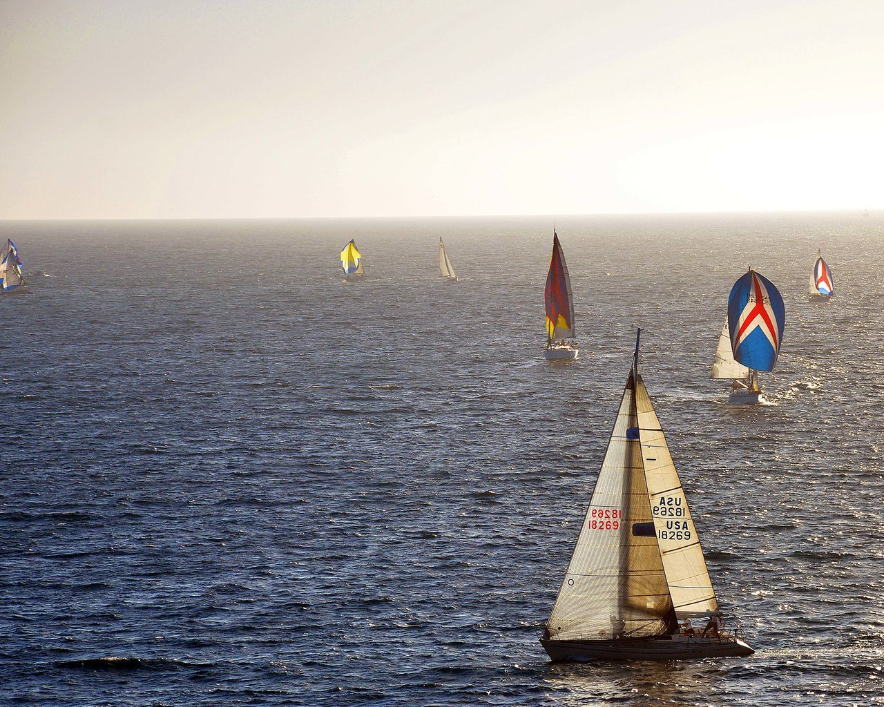 sea, flag, water, horizon over water, sailboat, tranquility, nature, day, transportation, adventure, no people, sky, outdoors, sailing, clear sky, scenics, nautical vessel, beauty in nature