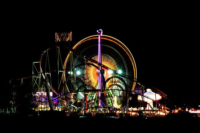 Kirmes in Düsseldorf Amusement Park Arts Culture And Entertainment Night Amusement Park Ride Ferris Wheel Illuminated Colour Your Horizn Fun Outdoors Multi Colored Circle Excitement Traveling Carnival Rollercoaster No People Summer Carousel Black Background Sky