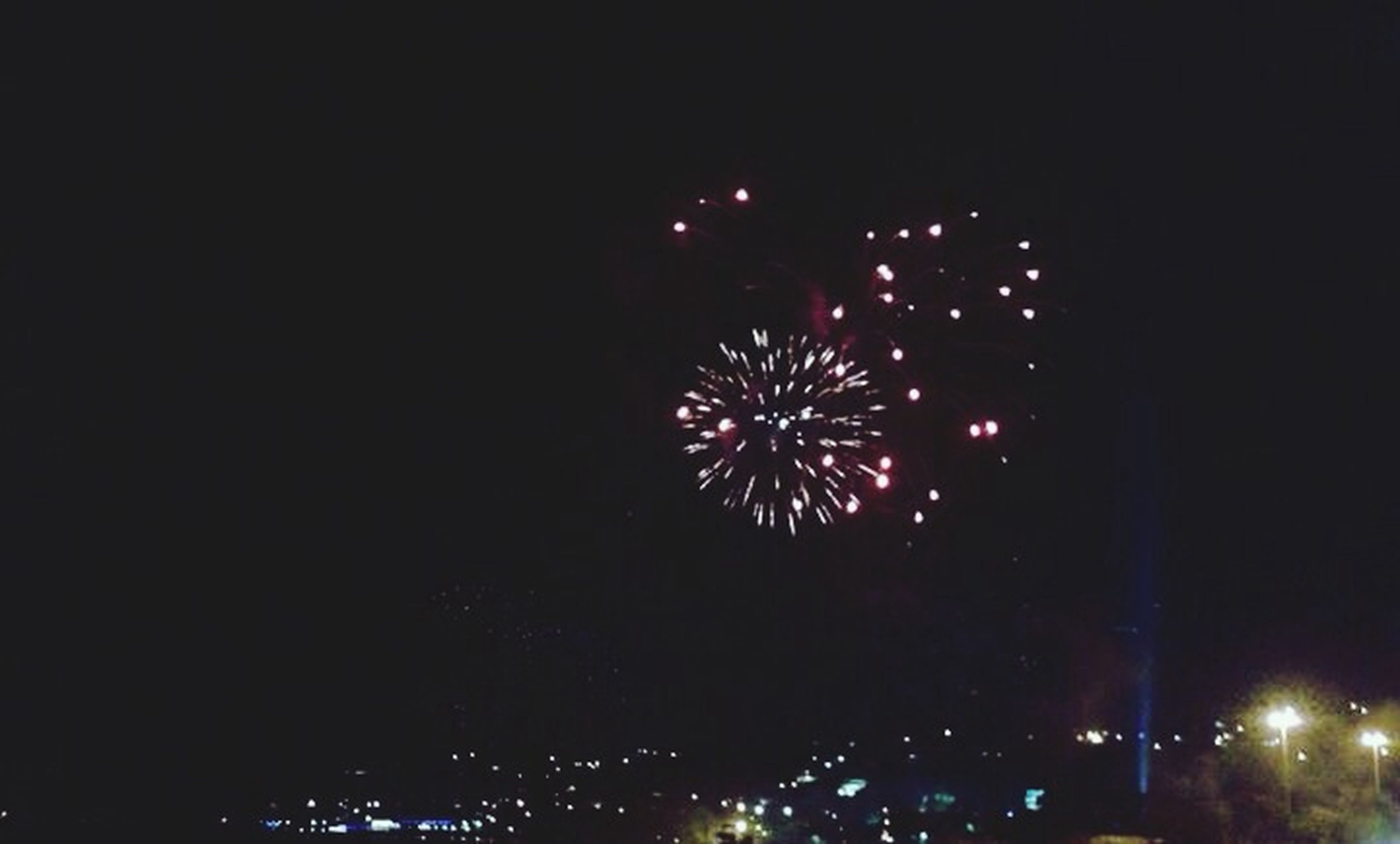 night, illuminated, firework display, celebration, exploding, long exposure, firework - man made object, arts culture and entertainment, motion, event, glowing, sparks, blurred motion, firework, sky, entertainment, low angle view, celebration event, lighting equipment, outdoors