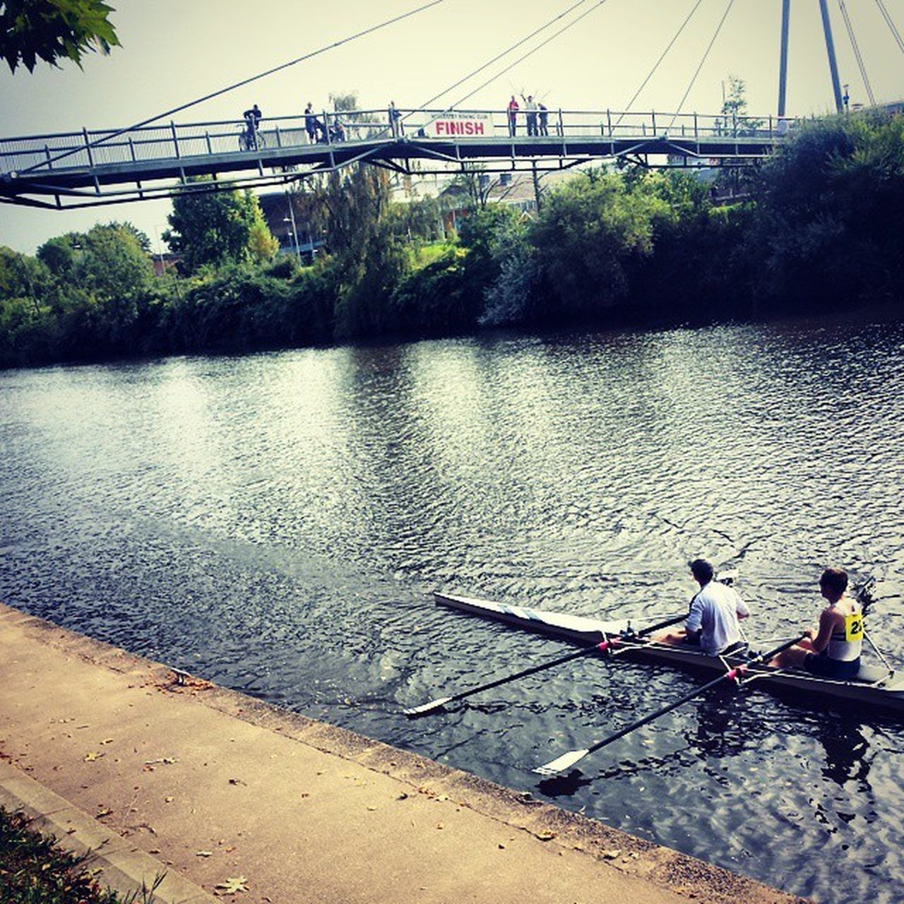 water, river, transportation, real people, day, nature, mode of transport, nautical vessel, bridge - man made structure, outdoors, sitting, tree, oar, two people, men, rowing, togetherness, sky, adult, people