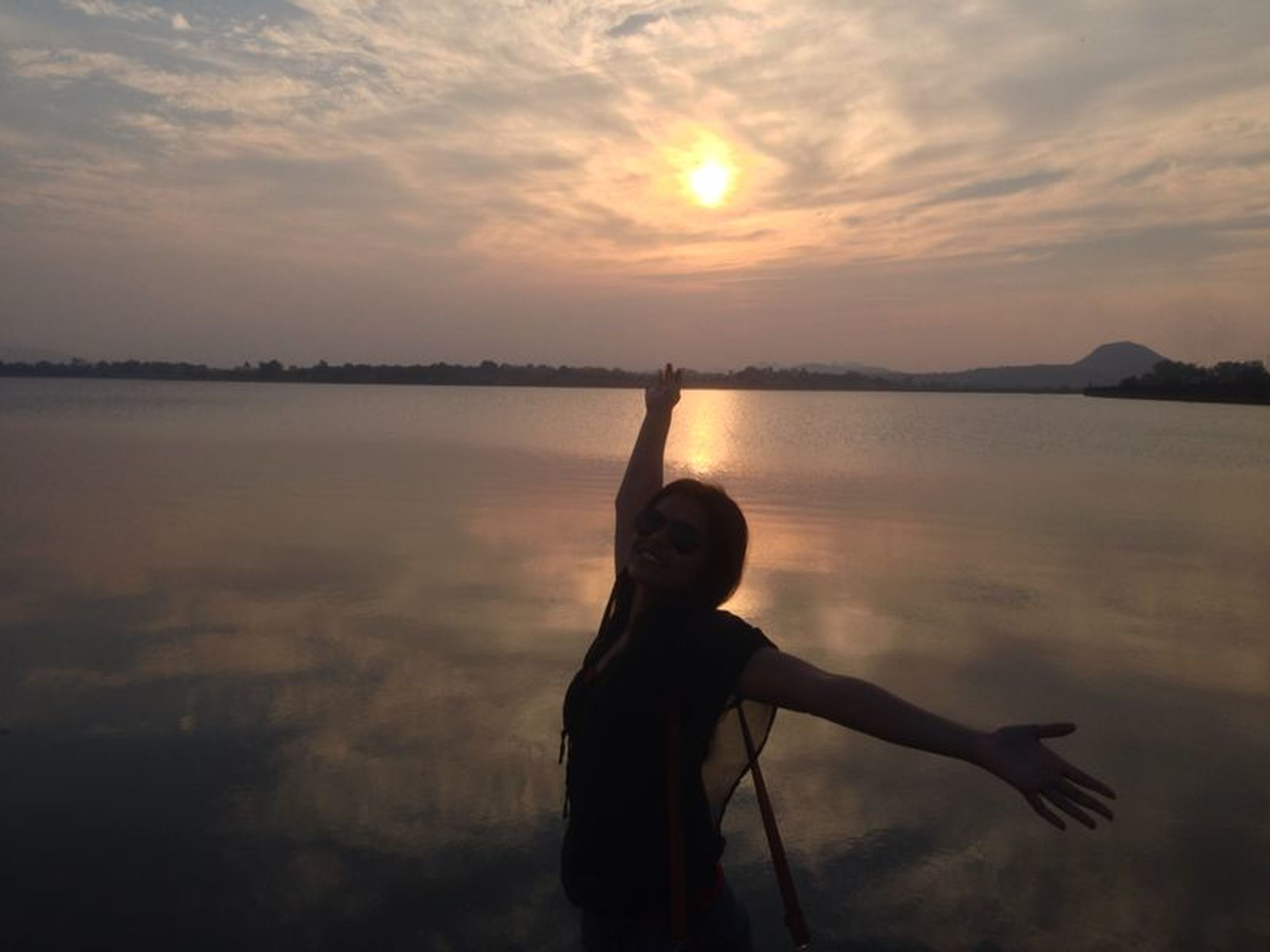 sunset, sky, water, silhouette, sun, sea, cloud - sky, standing, beauty in nature, scenics, cloud, reflection, lifestyles, tranquility, leisure activity, tranquil scene, nature, orange color