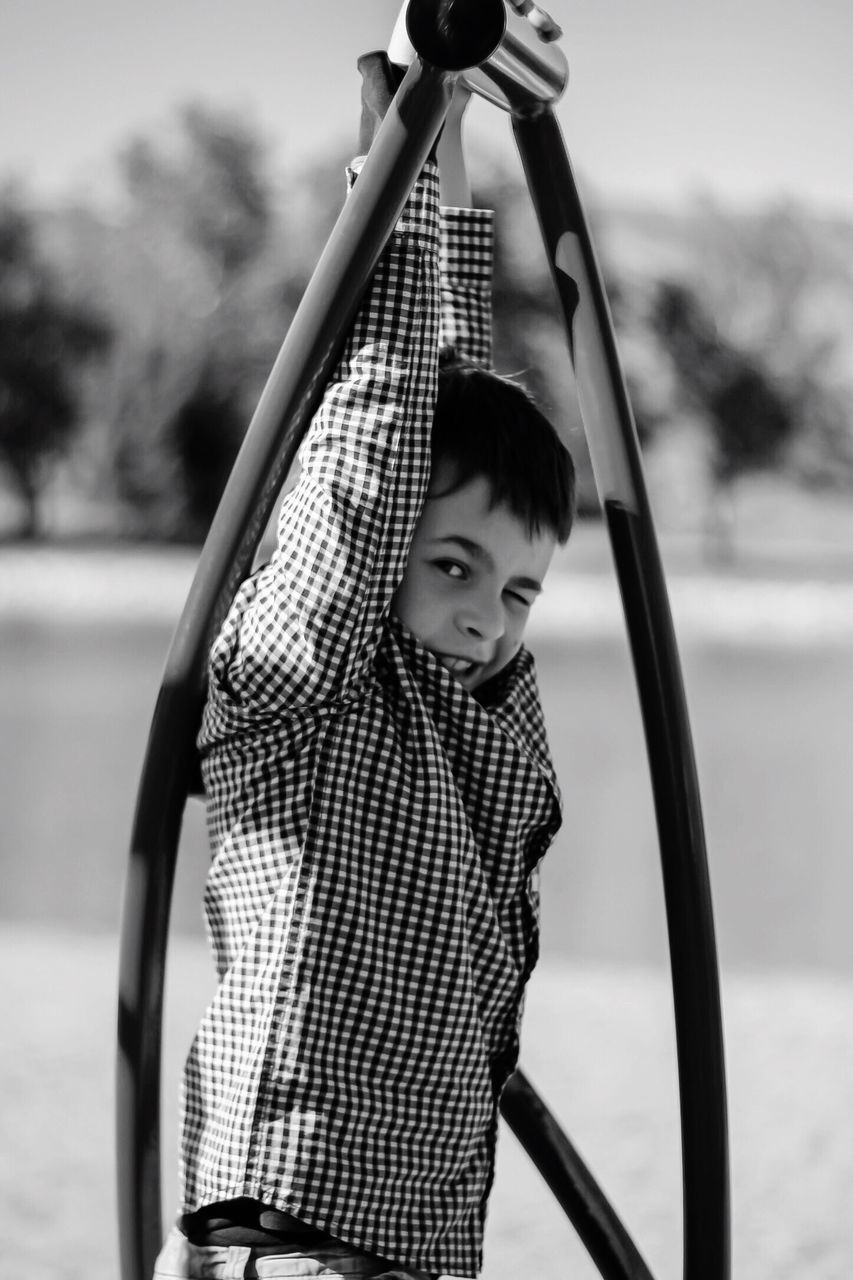 Boy Hanging From Play Equipment