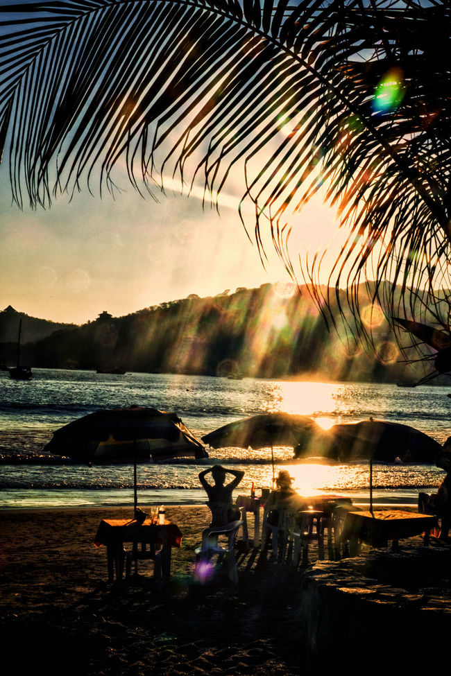 Sunset at the beach Beauty In Nature Idyllic Leisure Activity Lens Flare Me Outdoors Scenics Shopping Sun Sunset Tourism Tranquility Travel Destinations Vacations Water Zihuatanejo
