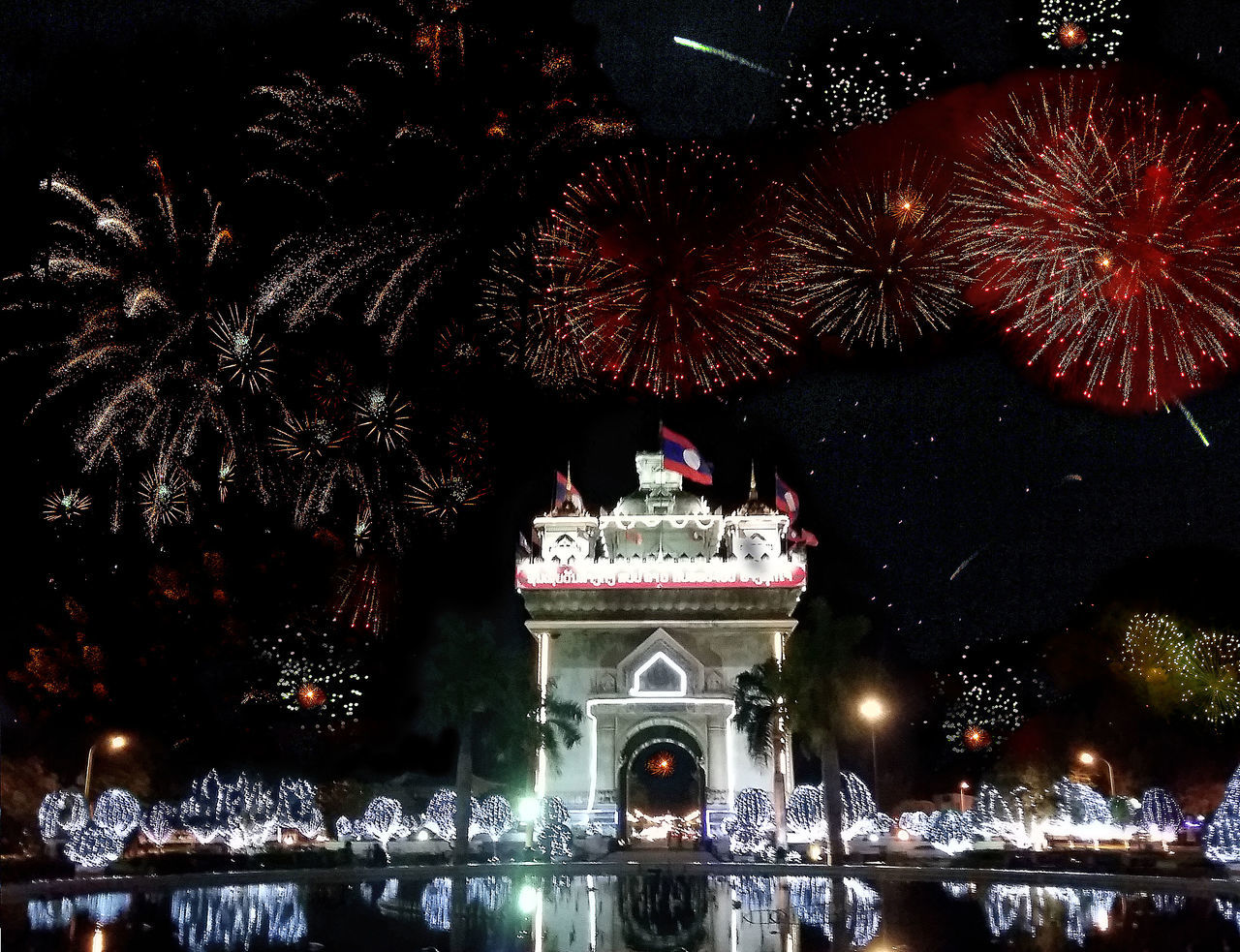 Tourist Attraction  Southeastasia Johnnelson Lifeasiseeit Vientiane Vientiane Laos Laospdr Red Sky Check This Out Night Lights Fire In The Sky Fireworks Patuxai Victory Monument Park (Patuxay)Vientaine Laos Patuxay Patuxaypark Explosions In The Sky Southeast Asia Celebration