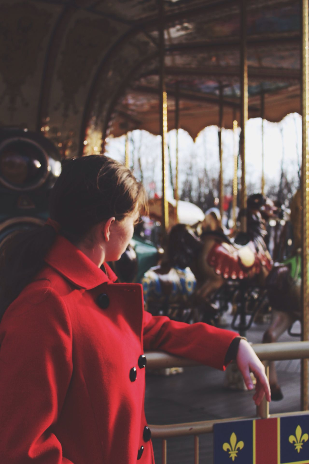 Real People Lifestyles One Person Leisure Activity Amusement Park Carousel Amusement Park Ride Childhood Day Outdoors Young Adult