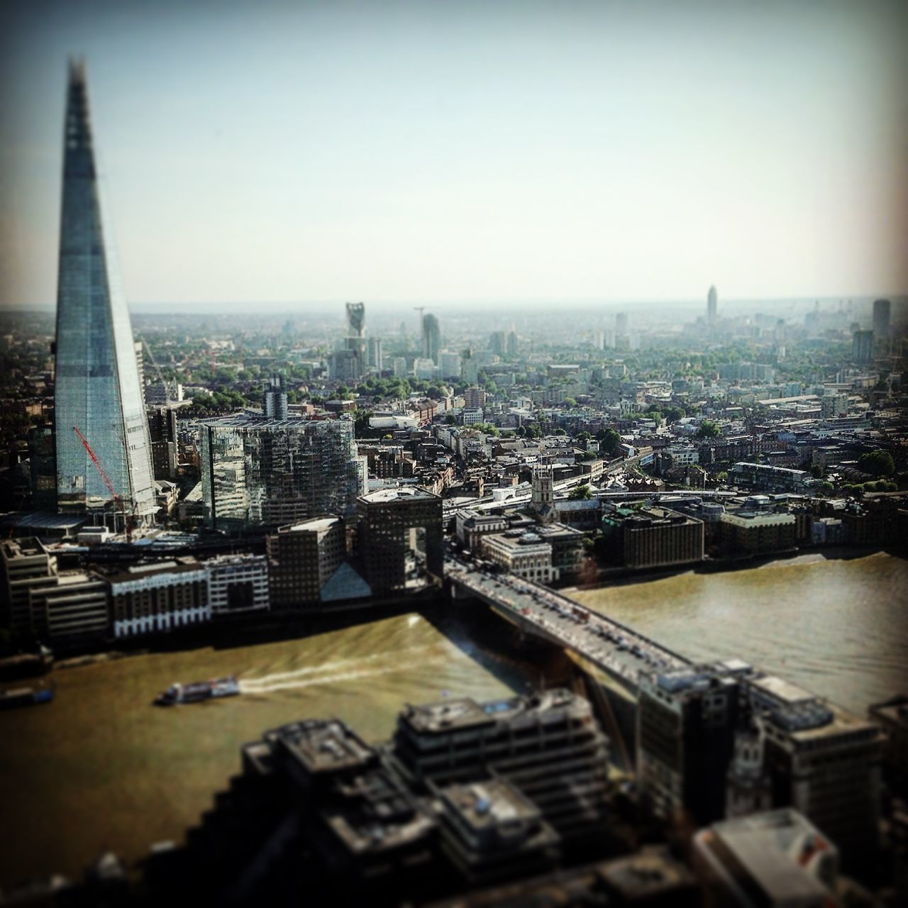 architecture, cityscape, city, building exterior, built structure, crowded, skyscraper, travel destinations, tower, development, high angle view, skyline, city life, clear sky, day, river, outdoors, wide, tilt-shift, tall, modern, sky, urban skyline