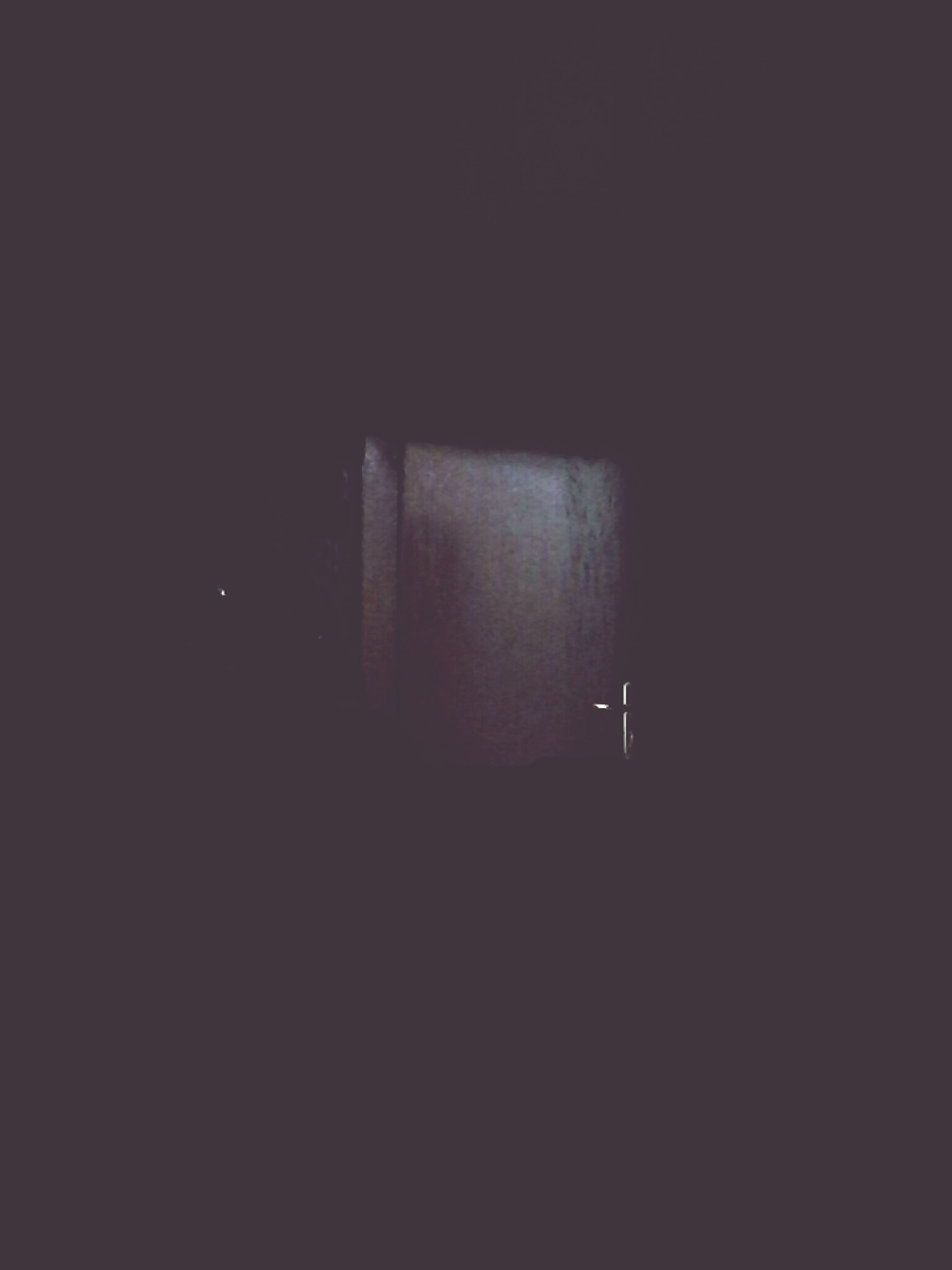indoors, dark, copy space, illuminated, night, darkroom, lighting equipment, wall - building feature, window, no people, built structure, architecture, light - natural phenomenon, wall, electricity, studio shot, black background, home interior, low angle view, reflection