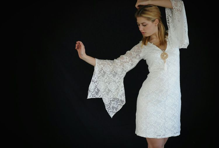 Fashion Photography Model Pose or Dance? White Lace Dress Black Background Blonde Girl