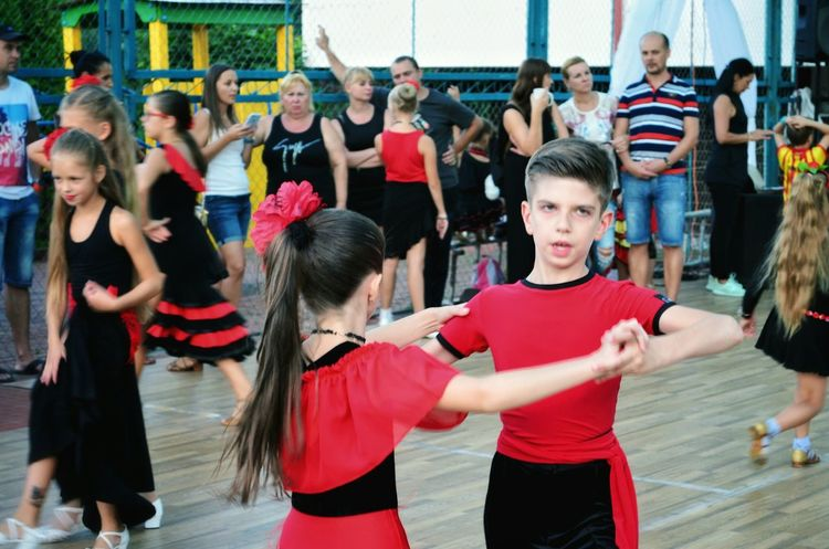 Friendship People Spanish Style Dance Floor Real People Dancer Coach Music Leisure ActivityPortrait Child Two People Enjoyment Outdoors Arts Culture And Entertainment Motion Dancing Dance Ballroom Dancing Healthy Lifestyle Competition Sport Boys And Girls Red Togetherness