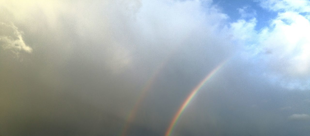 rainbow, double rainbow, scenics, nature, beauty in nature, multi colored, cloud - sky, low angle view, no people, sky, weather, outdoors, day, spectrum, idyllic, tranquil scene, refraction