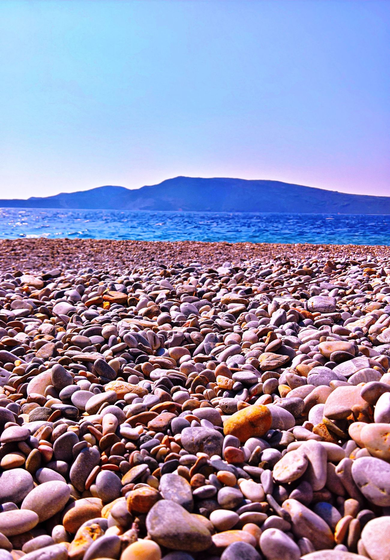 Beach with stones in Alonissos Alonnisos Beach Beauty In Nature Colors Beachphotography Greece Summer Life Is A Beach EyeEm Best Edits Nature Beauty In Nature Pebble Beach No People Beautiful Nature Check This Out Nature Photography Nature Sea Sea And Sky Landscape Enjoying The View