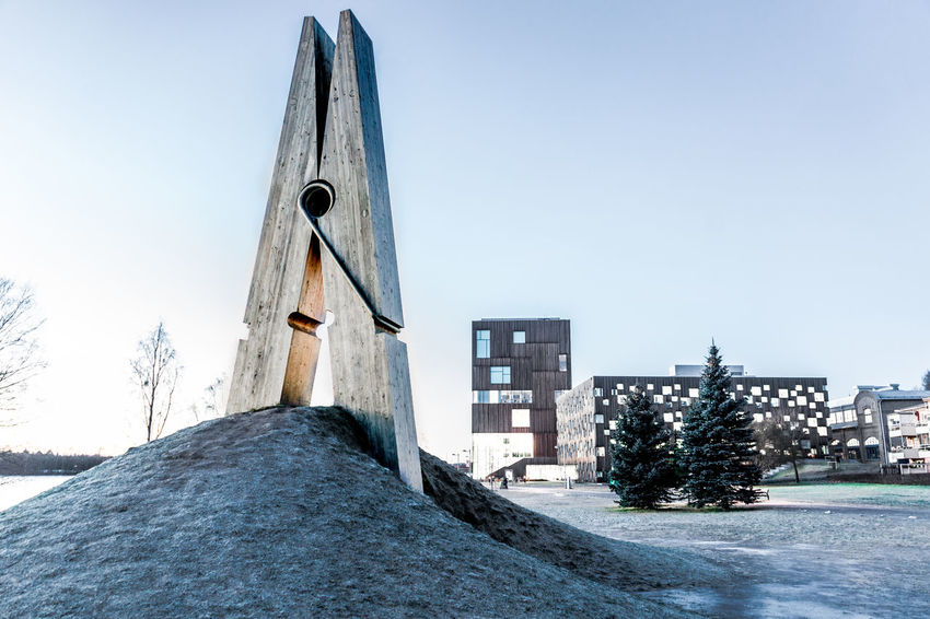 Clothes Peg in Umeå Sweden. Architecture Blue Building Building Exterior Built Structure City Clear Sky Clothes Peg Copy Space Day Diminishing Perspective House Low Angle View Monument No People Outdoors Residential Building Residential Structure Sculpture Sky Street Sweden The Way Forward Umeå Winter