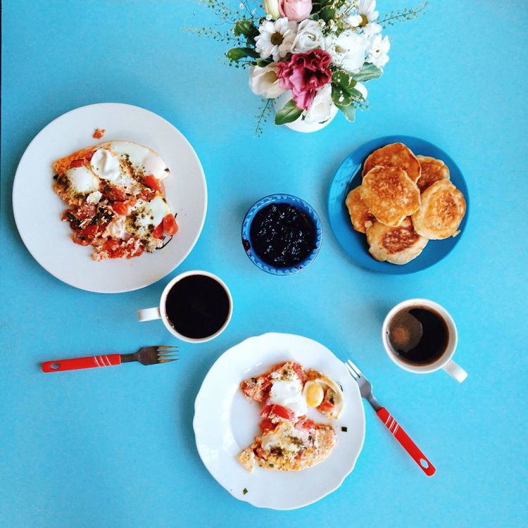 Freshness Food Plate Of Food Plate Ready-to-eat Still Life Spoon Directly Above Breakfast Meal Serving Size Served Cup Of Coffee Overhead View Close-up Blue Background Flowers On Table Pancakes Fried Egg Food On The Table Mealtime Multi Colored White Plate Visual Feast