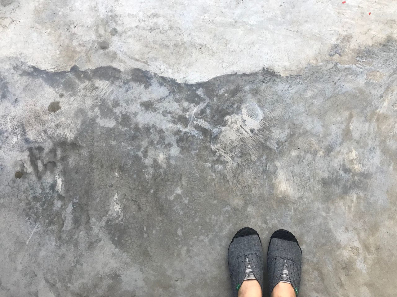 Sanook Sneakers Shoes Low Section Standing Human Leg Personal Perspective Human Body Part One Person Real People Outdoors High Angle View Day Directly Above Lifestyles Cement Floor Adult People
