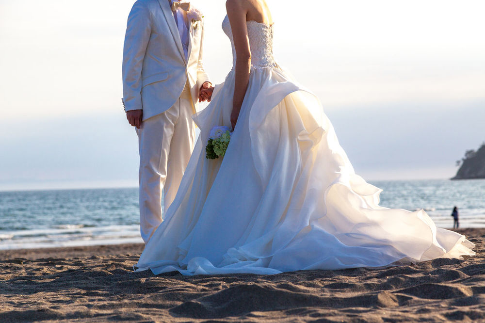 Wedding photography on a beach Beach Bride Bridegroom Heterosexual Couple Husband Life Events Love Newlywed No Head S No Head Shot Outdoors Romance Sea Togetherness Two People Wedding Wedding Dress Wedding Photography On Beac White Wife Beautifully Organised