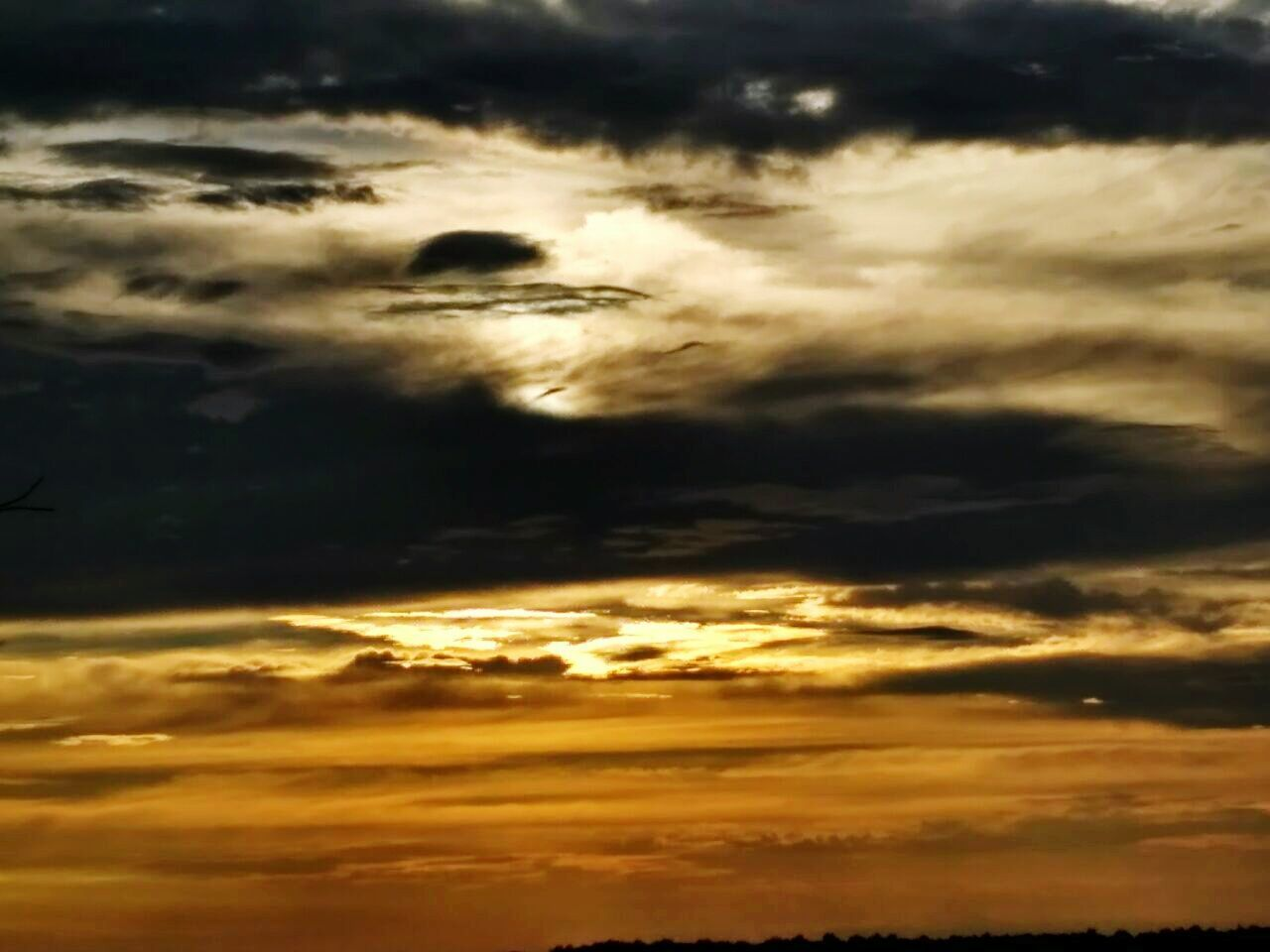 cloud - sky, sunset, dramatic sky, sky, cloudscape, atmospheric mood, scenics, beauty in nature, nature, tranquility, majestic, tranquil scene, weather, sky only, silhouette, storm cloud, no people, idyllic, backgrounds, awe, outdoors, low angle view, sunlight, yellow, day