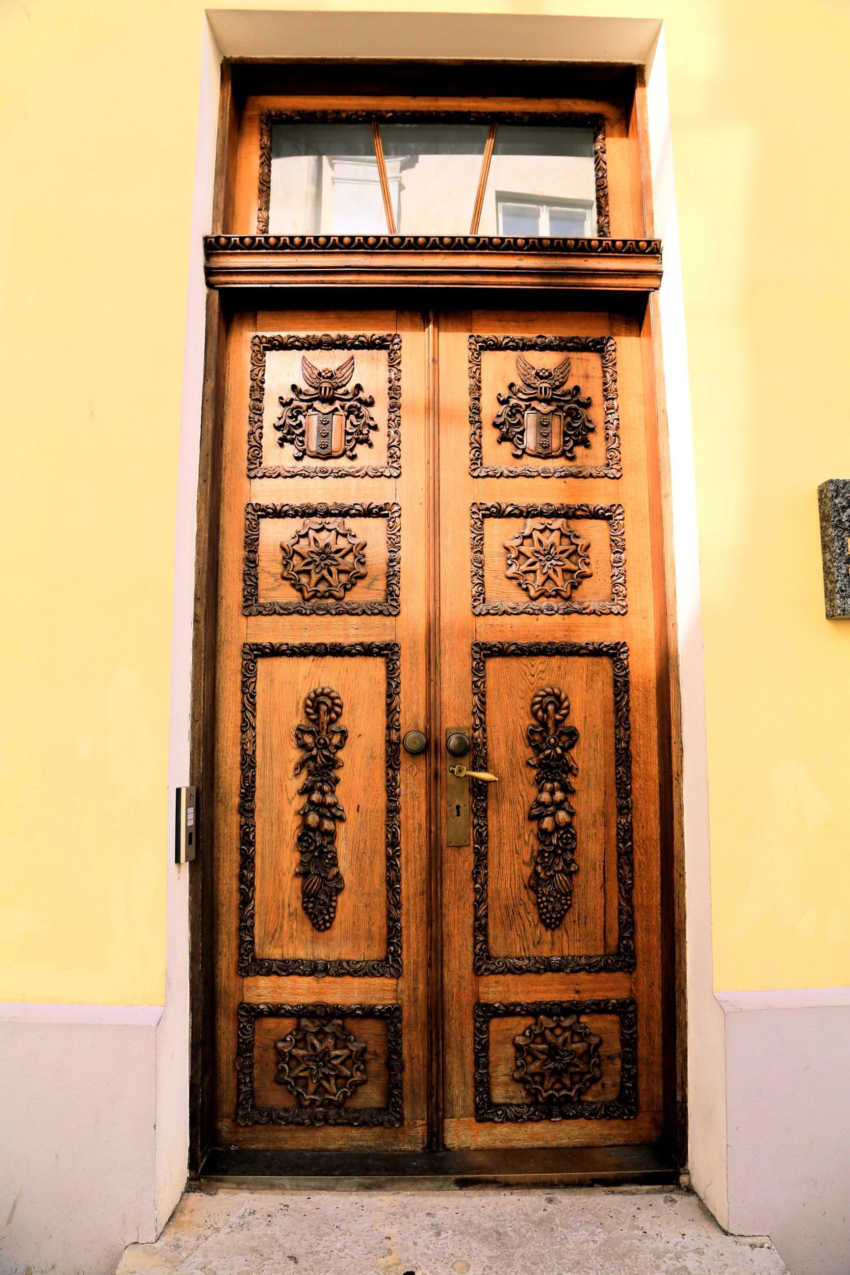 door, architecture, built structure, closed, building exterior, entrance, yellow, window, house, wood - material, wall - building feature, ornate, protection, safety, day, art, no people, doorway, design, facade