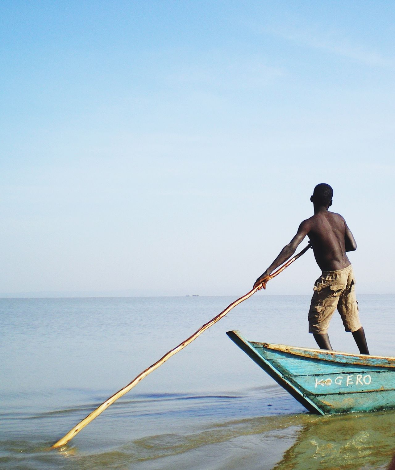Real People Sea One Person Lifestyles Full Length Water Fisherman Outdoors Holding Men Clear Sky Oar Nautical Vessel Horizon Over Water Day Sky Occupation Nature Beauty In Nature Working Kenya