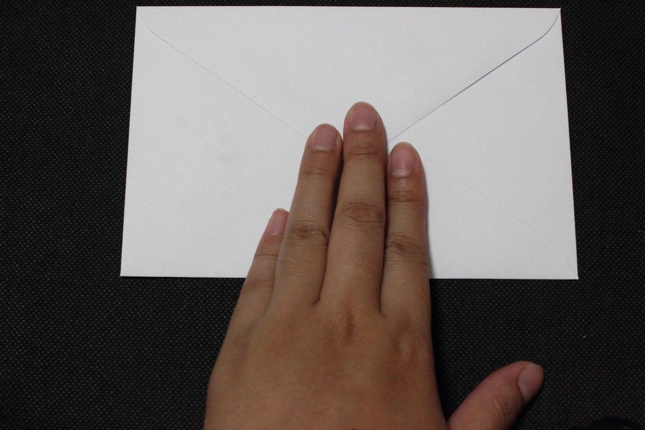 human hand, human finger, human body part, one person, showing, paper, close-up, real people, indoors, day, people