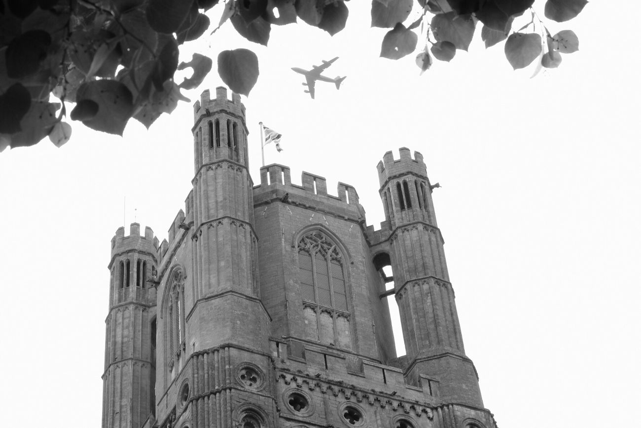 A plane flies over Ely cathedral. Plane Cathedral Ely