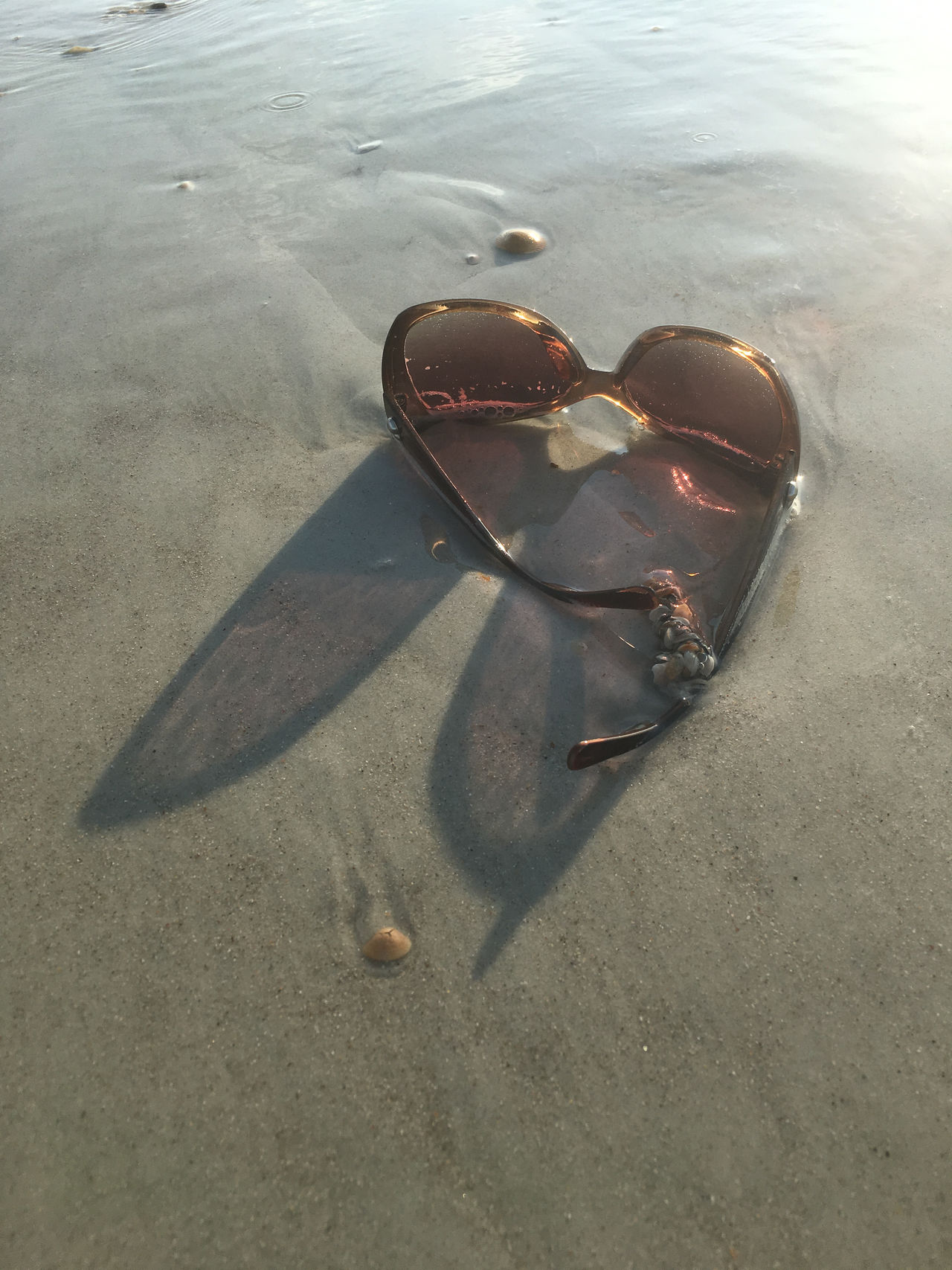 Sunglasses reflecting shadows Beach Beach Photography Close-up Day High Angle View Nature No People Outdoors Reflection Sand Shadows & Lights Sunglasses Water