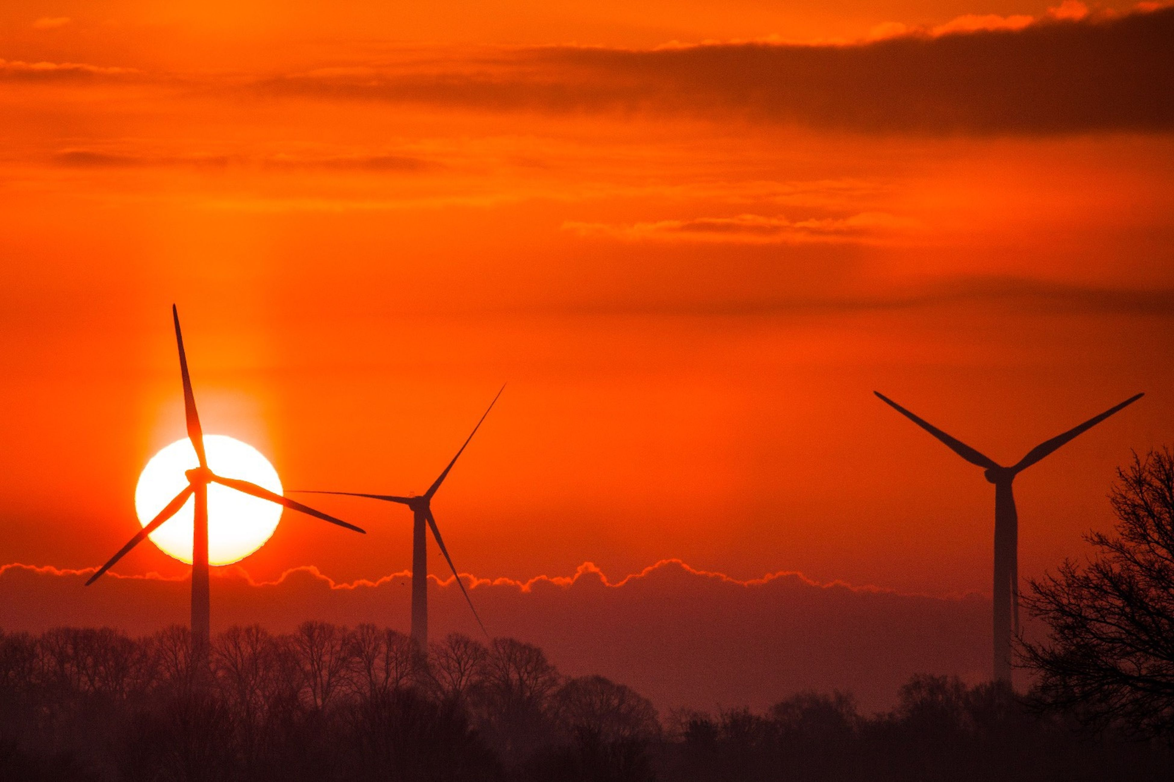 sunset, alternative energy, fuel and power generation, renewable energy, wind turbine, wind power, environmental conservation, orange color, windmill, nature, industrial windmill, beauty in nature, sky, sun, silhouette, scenics, no people, tranquility, outdoors, tranquil scene, field, technology, mountain, traditional windmill, day