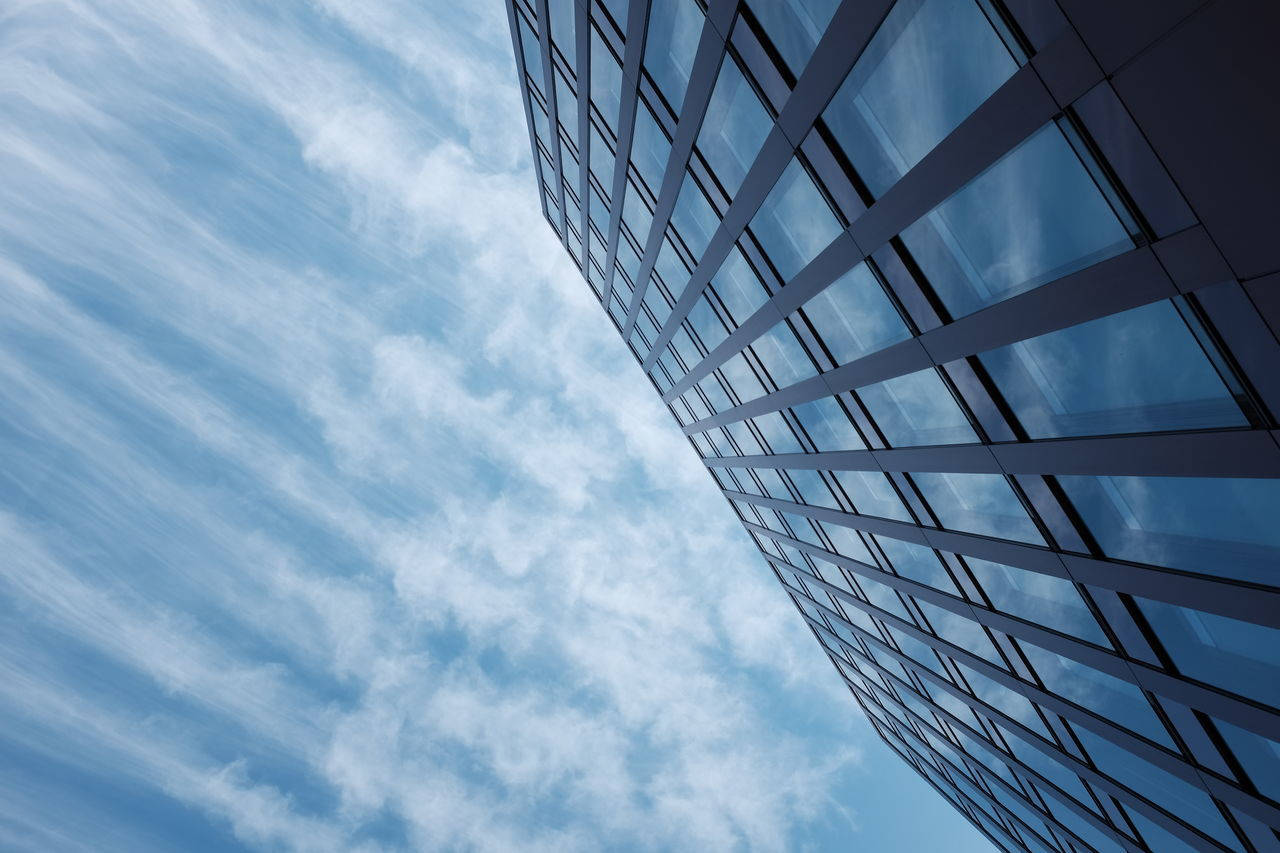 sky, cloud - sky, architecture, low angle view, built structure, building exterior, reflection, modern, window, day, skyscraper, no people, outdoors, corporate business, city, blue