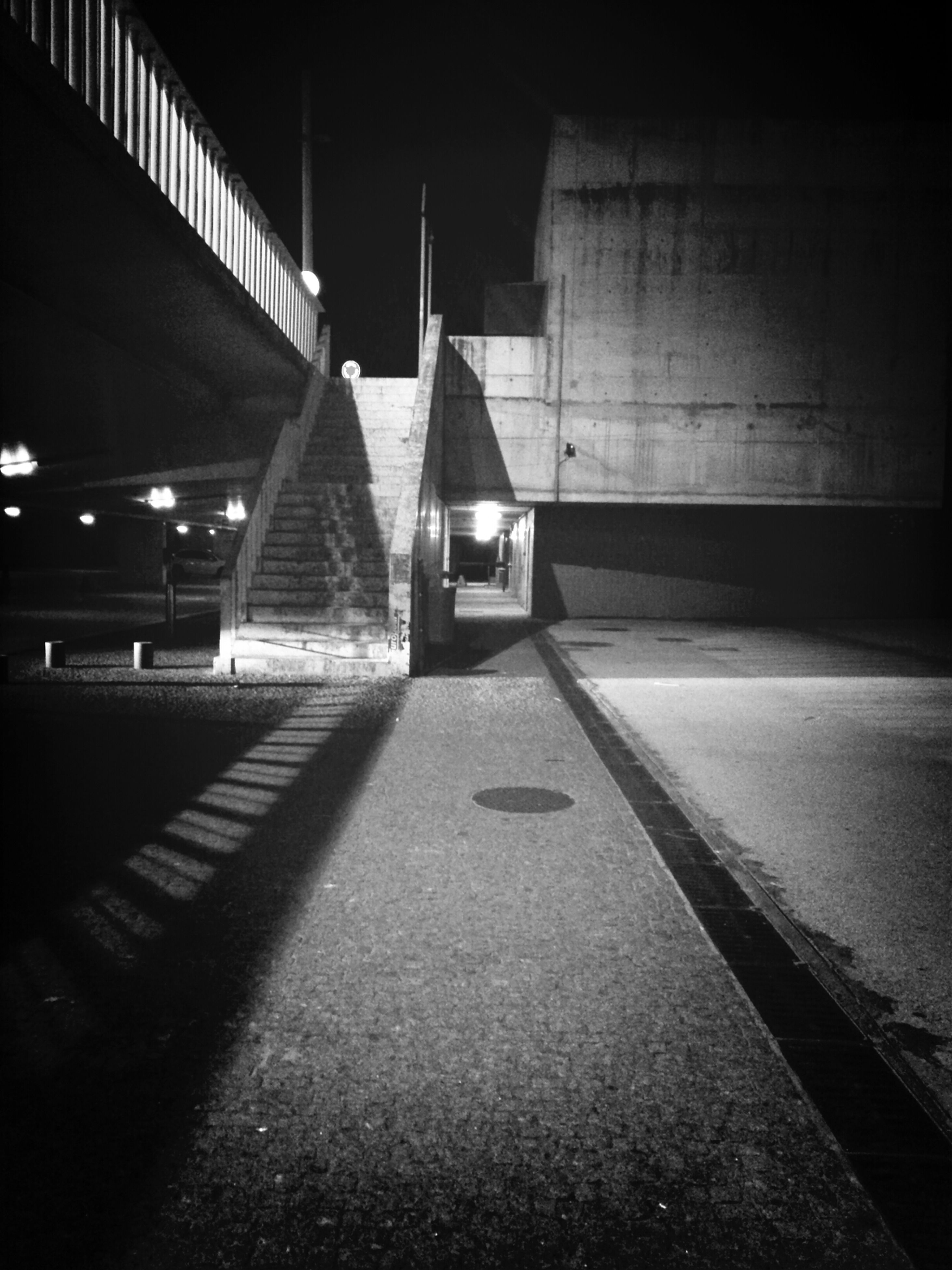 transportation, night, illuminated, the way forward, road, street, built structure, mode of transport, architecture, lighting equipment, road marking, empty, land vehicle, diminishing perspective, car, vanishing point, street light, no people, outdoors, railing
