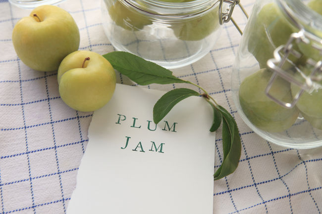 Fresh green plums with plum jam words Blue Communication Copy Space Dish Towel Foliage Food Food Preparation Fresh Fruit Glass Jars Green Plums Indoors  Indoors  Leaves Letters Making Jam Natural Light No People Overhead Pattern Text Textures Type Typography White Words