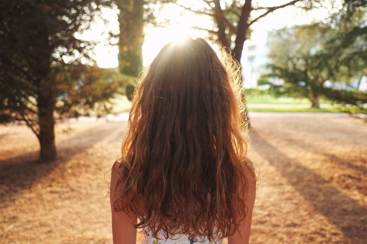 Rear View Of Woman At Park