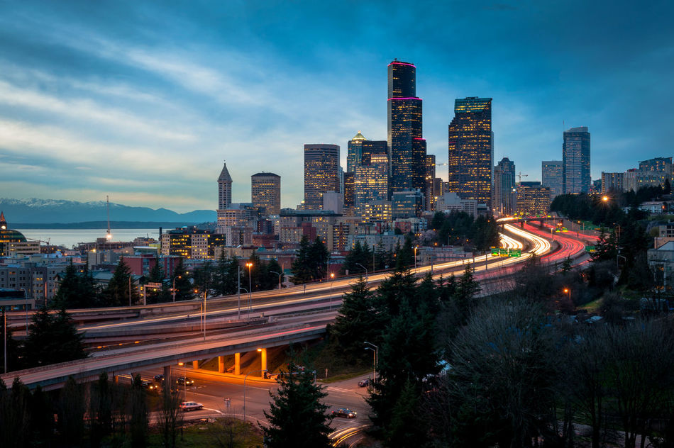 """Seattle Skyline. All freeways lead to the """"Emerald City"""" during a lovely sunset. Seattle, Washington, USA. Architecture Automobile Cars City City Life Cityscape Colorful Commute Commuting Development King County Modern Motion Office Building Outdoors Rush Hour Seattle Skyline Skyscraper Tower Transportation Travel Traveling Washington Washington State"""