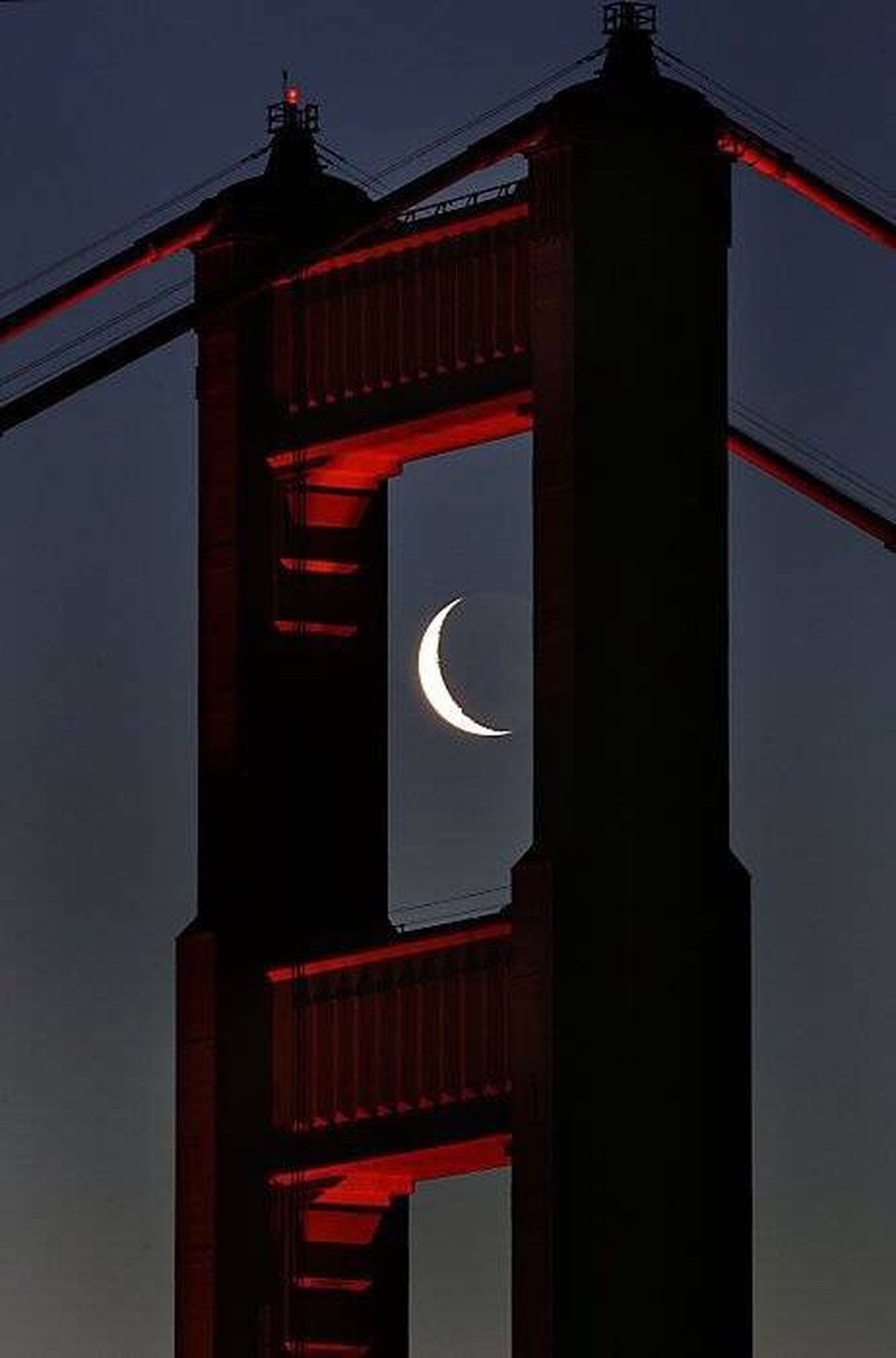 architecture, built structure, building exterior, red, low angle view, illuminated, clear sky, connection, sky, night, bridge - man made structure, no people, house, building, outdoors, lighting equipment, bridge, dusk, architectural column, lantern