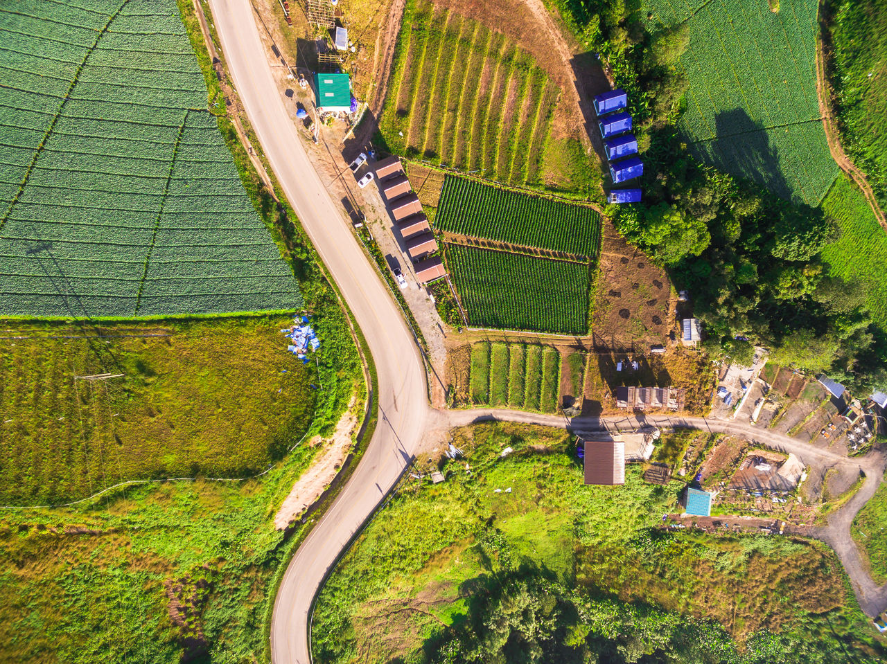 aerial view Agriculture Architecture City Cityscape cultures day Drone Fame Grass Green color Growth hot air balloon landscape Modern Nature no people outdoors Road rural scene Transportation Travel travel destinations Tree