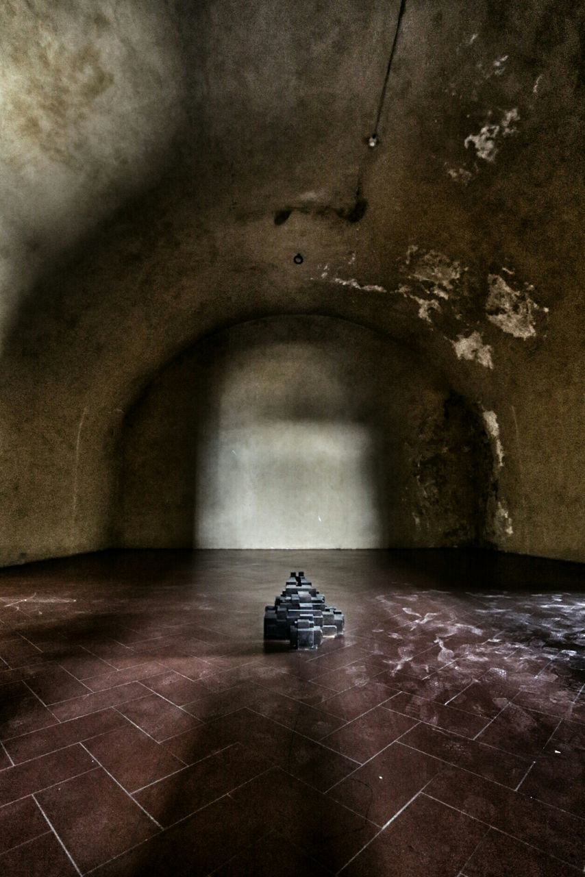 indoors, history, arch, architecture, built structure, day, tunnel, one person, real people, prison, people